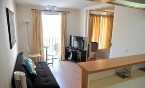 A television and/or entertainment center at Lastarria Santiago Suite Apartments