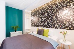 Tempat tidur dalam kamar di Vagabond Broadway