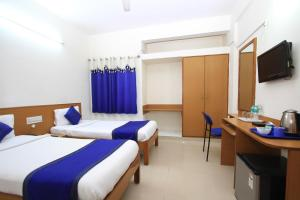 A bed or beds in a room at Arra Suites