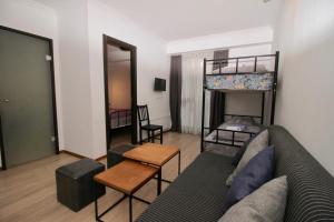 Svetainės erdvė apgyvendinimo įstaigoje Apartment N322 Gudauri Loft