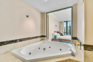 A bathroom at Legends 1 Bedroom Spa Suite - We Accommodate