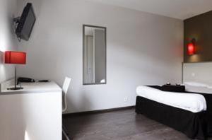 Un ou plusieurs lits dans un hébergement de l'établissement Résidence Hôtelière Temporim Part Dieu
