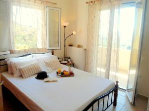 A bed or beds in a room at Aloe Villa