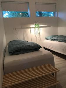 A bed or beds in a room at Downtown Selfoss - perfectly located apartment