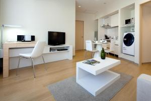A television and/or entertainment center at Fraser Residence Nankai Osaka