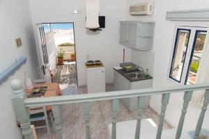 A kitchen or kitchenette at Captain Manos Studio Apartments
