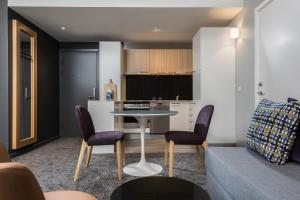 A kitchen or kitchenette at Adina Apartment Hotel Copenhagen
