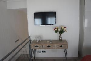 TV/Unterhaltungsangebot in der Unterkunft Arizonica Suites