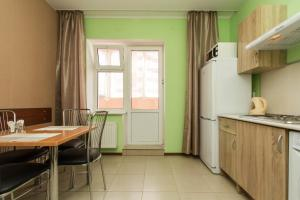 A kitchen or kitchenette at SleepPanorama