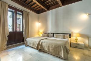 Cama o camas de una habitación en Elvira Suites