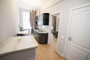 Kuchnia lub aneks kuchenny w obiekcie Vicheva apartments