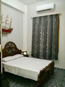 Un pat sau paturi într-o cameră la Apartament Rosario