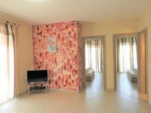 A television and/or entertainment center at Apartments Kidonis