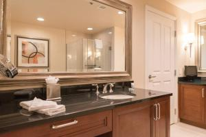 A bathroom at True 1BR Balcony Suite with Strip View at MGM Signature