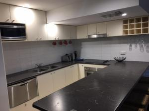 A kitchen or kitchenette at Merrima Court Holidays