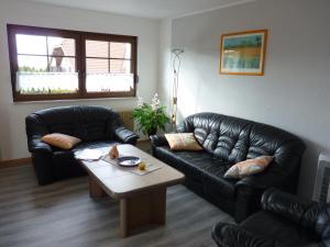 Ein Sitzbereich in der Unterkunft Haus Maria