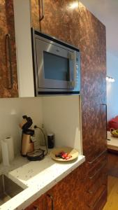 A kitchen or kitchenette at Huis Roomolen
