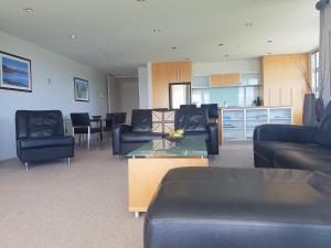 A seating area at Waimahana Apartment 8
