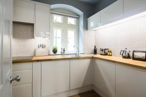 A kitchen or kitchenette at Hiding Space - St Catherine's Hospital