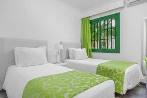 A bed or beds in a room at Club del Carmen By Diamond Resorts