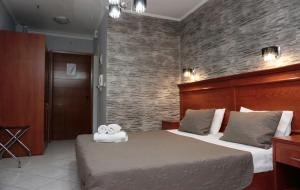 Кровать или кровати в номере Paradise