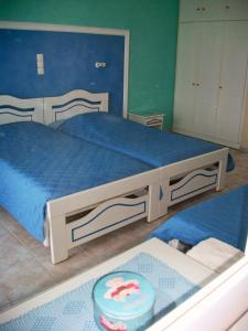 A bed or beds in a room at Diona Studios