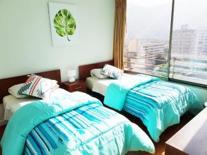 Cama o camas de una habitación en DSP Apart Nueva Providencia 1372