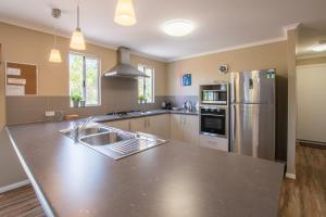 A kitchen or kitchenette at Cape Howe Cottages