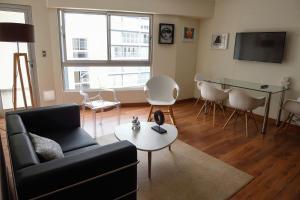 A seating area at Eduardo Designer Apartments Miraflores