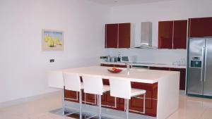 A kitchen or kitchenette at Pallinion Apartment Beachfront