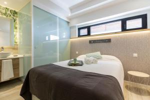 Llit o llits en una habitació de Monopoly Madrid
