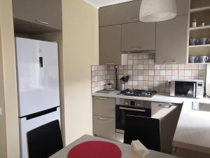 A kitchen or kitchenette at ApartVBG at Moskovskiy 16