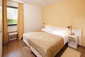 Postelja oz. postelje v sobi nastanitve Apartments Sol Amfora for Plava Laguna