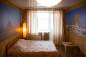 Кровать или кровати в номере Apartment on Moskovskaya 4A