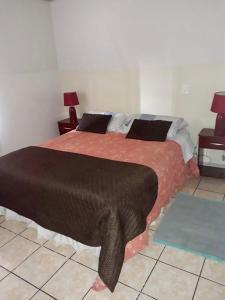 Cama o camas de una habitación en Departamento Amoblado Vitacura, Dpto 704