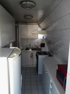 Una cocina o zona de cocina en Apartamento Amoblado Vitacura 6 personas con terraza