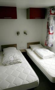 Ein Bett oder Betten in einem Zimmer der Unterkunft Chalet Espérance