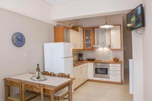 Kuchnia lub aneks kuchenny w obiekcie Remezzo Apartments