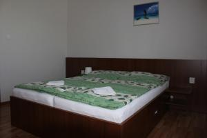 A bed or beds in a room at Privat Arcadia