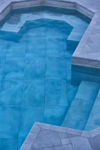 The swimming pool at or near 9 Muses Exclusive Apartments