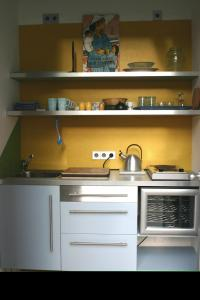A kitchen or kitchenette at Hauptstadt Apartment