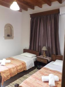 A bed or beds in a room at Villa Polymnia