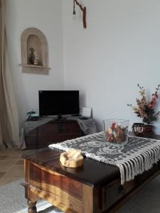 A television and/or entertainment center at Villa Polymnia