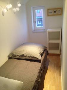 מיטה או מיטות בחדר ב-Loft