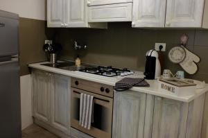 Kitchen o kitchenette sa Filarmonico12