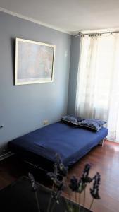 Cama o camas de una habitación en Santiago Wine Rent Apartments