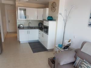 A kitchen or kitchenette at Playa Paraiso II