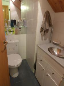 Un baño de Departamento Armonias