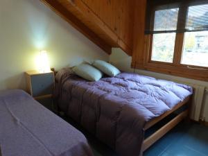 Una cama o camas en una habitación de Departamento Armonias