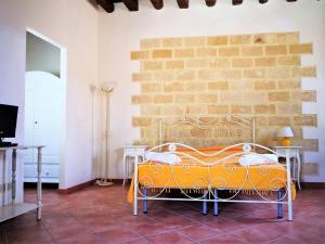 Letto o letti in una camera di Appartamenti la Pinetina di Favignana